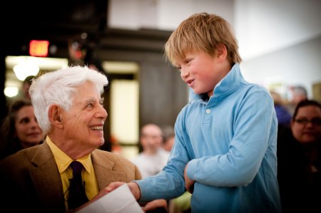 Wolf Kahn chats with his grandson, Mason Foard, at a past Brattleboro Museum & Art Center program. Photo: Kelly Fletcher.