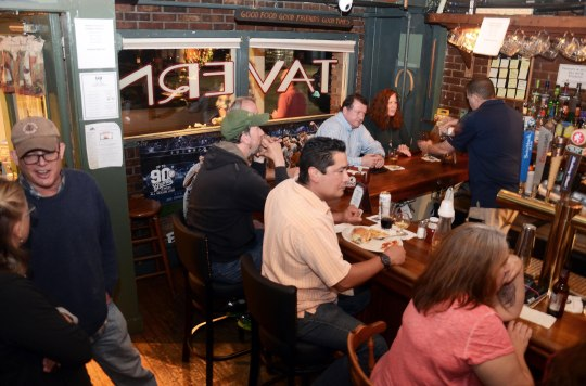 Guests enjoy the tavern atmosphere at Kevin's. Photo: Caroline Bonniver Snyder