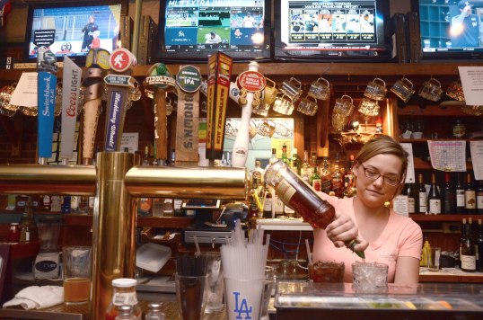 Carly Scheerer tends bar at Kevin's. Photo: Caroline Bonniver Snyder