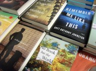 Novelists, poets and nonfiction writers showcase their work on sales tables. Photo: Kevin O'Connor
