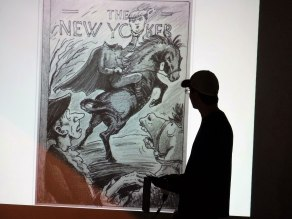 Vermont artist Harry Bliss stands in silhouette during a slide show featuring his illustrations for the New Yorker magazine. Photo: Kevin O'Connor