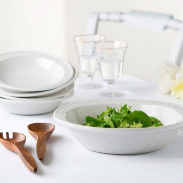 Bennington Potters elegant handcrafted NewLine serving bowl set includes your choice of free salad servers for a limited time, a $15-$18 value. Available in 10 signature glazes, shown here in White on White. Bennington Potters pottery is lead free and dishwasher, oven and microwave safe. $159-$189. Bennington Potters 324 County St., Bennington, Vt. 800-205-8033 benningtonpotters.com
