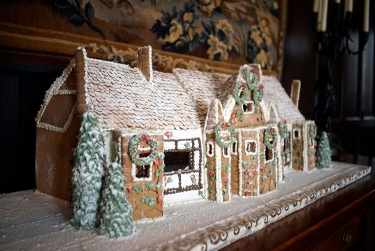 A replica of Blantyre in gingerbread sits in the main dining room of Blantyre. The gingerbread house took two weeks to make and has a roof of toasted almonds, gelatin windows and trees made of icing and ice-cream cones. The house was made by pastry chef Kim Watson. Photo: Ben Garver