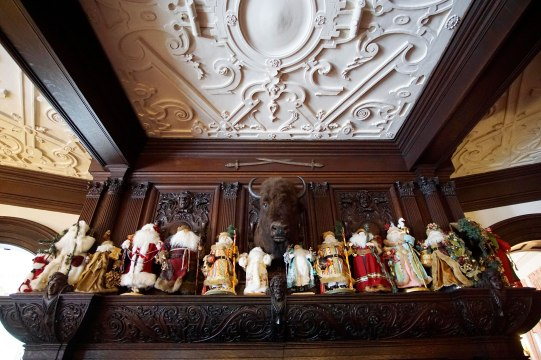 The fireplace in the main hall at Blantyre has a collection of Santa dolls for the holidays. Photo: Ben Garver