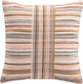 """Designed by Annie herself, this 18"""" x 18"""" decorative pillow features variegated metallic stripes in on-trend rose gold, pewter, copper, and silver — a perfect gift for someone who's glamourous and chic! A chain stitch embroidery center creates intersecting hues. $160. Annie Selke Pop-up Shop 36 Main St., Lenox, Mass. 413-551-7624 annieselke.com"""