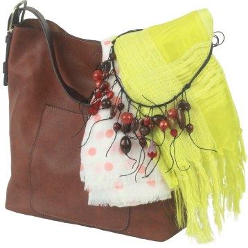 """This boho purse measures 12"""" x 16"""" x 4"""" and features interior hooks for a crossbody strap, studded coin purse, and three interior pockets. $69. Art and Chocolate 4 Housatonic St., Lenox, Mass. 413-637-9114"""