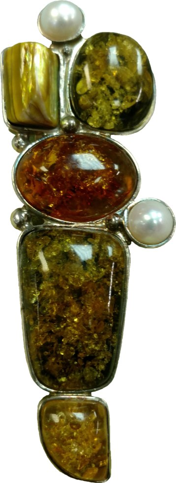 "Multi-color amber pendant in a solid sterling setting. This stunning piece shows off 3 different colors of amber. This is a new piece from NYC. 16""-22"" solid sterling chains sold separately. Pendant only: $80. With chain: $90-$96. Second Hand Rose 303 Depot St., Bennington, Vt. 802-447-1563"