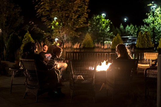 You'll find both warmth and conversation around the Kimpton Taconic Hotel's outdoor firepit.
