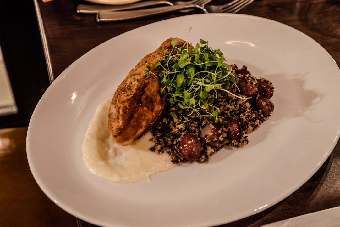 Chef Vanessa Davis' Adams Farm Stuffed Statler Chicken stuffed with Vermont chevre, topped preserved lemon puree, and served over a quinoa pilaf with roasted grapes.