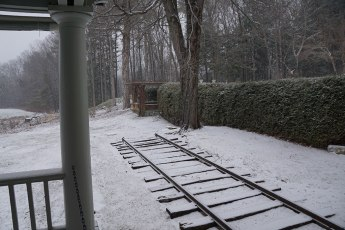 Most Daniel Chester French sculptures stand outdoors. This snow-covered rail track carried his works outside so he could get a true picture of the effect of light and shadow. Photo: Ruth Bass.