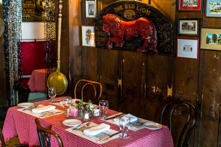 Pieces of the Red Lion's long history decorate the walls of Widow Bingham's Tavern. Photo: George Forbes.