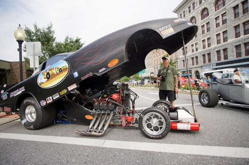 Paul Allen admires a funny car at Motorama. Photo: Ben Garver.