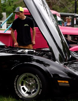 Joey Brown checks out some of the antique cars at the Vermont Veterans Home in Bennington, Vt. for the annual State Line Car Club Fathers' Day Car Show. Photo: Holly Pelczynski