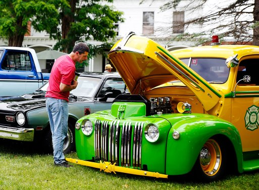 Jeff Edwards checks out some of the antique cars while at the Vermont Veterans Home in Bennington, Vt., for the annual State Line Car Club Fathers' Day Car Show. Photo: Holly Pelczynski.