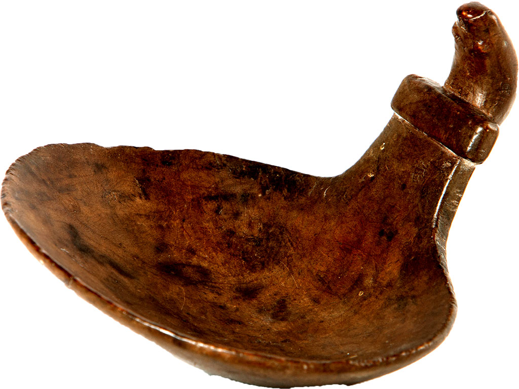 "Location: Mission House, Stockbridge, Mass. Made circa 1780, this hand-carved wooden scoop, featuring a carving of a beaver on its handle, was made by members of the Stockbridge Mohican Indians. ""It was used for scooping grain, food stores and for food processing,"" Wilson said. ""It's not too big. It's about 6 inches — hand-sized."" What makes the item unique is its age and condition. ""Wooden items like this don't often survive,"" he said. The scoop is part of a collection of historic items from the American Indian tribe on display at Mission House as part of an ongoing cultural collaboration with the Stockbridge-Munsee Community of the Mohican Nation which continues today in Wisconsin. Mission House, built in 1740 by John Sergeant, the first missionary to the Stockbridge Mohicans, was moved to its present location and restored between 1926 and 1929 by Mabel Choate, an early preservationist and owner of Naumkeag. Choate purchased several items from the Stockbridge-Munsee Community and numerous furnishings from the 16th and 17th century, including items from the Sergeant family, for the house. Photo: Michael Flowers — Provided by The Trustees of Reservations"