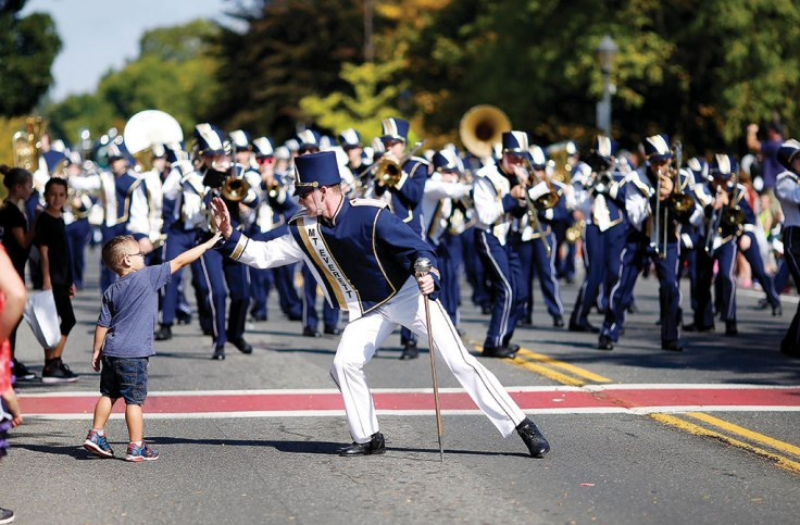The Mount Everett marching band gets involved with the crowd during the Lee Founders Weekend parade in Lee, Mass. Photo: Stephanie Zollshan