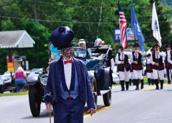 People line the main drag in Dover, Vt., to watch the parade during the annual Blueberry Festival. Photo: Kristopher Radder.