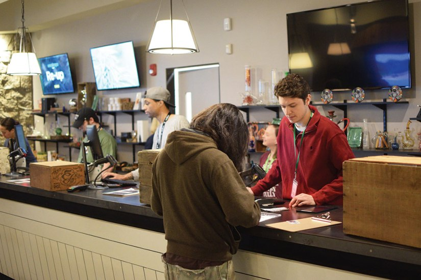 Customers purchase pot products at Berkshire Roots on its first day of recreational marijuana sales. Berkshire Eagle File Photo