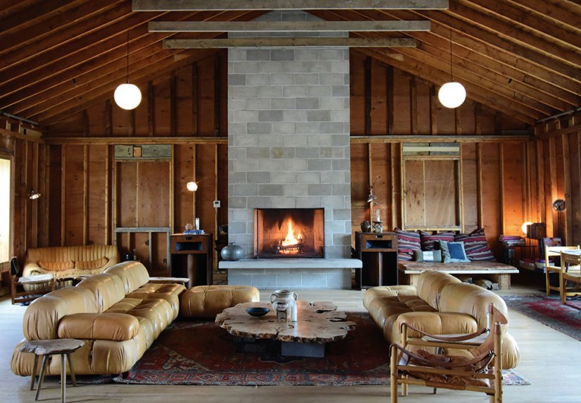 A fire burns in the fireplace of The Lodge, a central gathering spot at Tourists. Photo: Gillian Jones