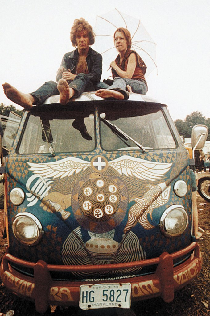 Concert-goers sit on the roof of a Volkswagen bus at the Woodstock Music and Arts Fair at Bethel, N.Y., in mid-August 1969. The three-day concert attracted hundreds of thousands of people, and became a landmark cultural event of the late '60s. Photo: The Associated Press