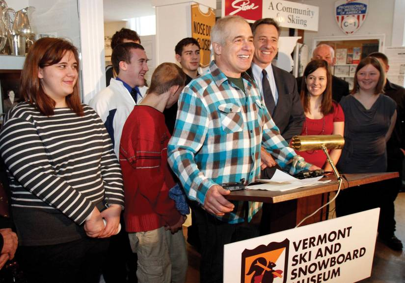 Jake Burton Carpenter, the creator of Burton Snowboards, seen in this file photo taken in Stowe, Vt., in 2012, celebrates with Gov. Peter Shumlin (to his right) the signing of the bill that made skiing and snowboarding the official state sports of Vermont.