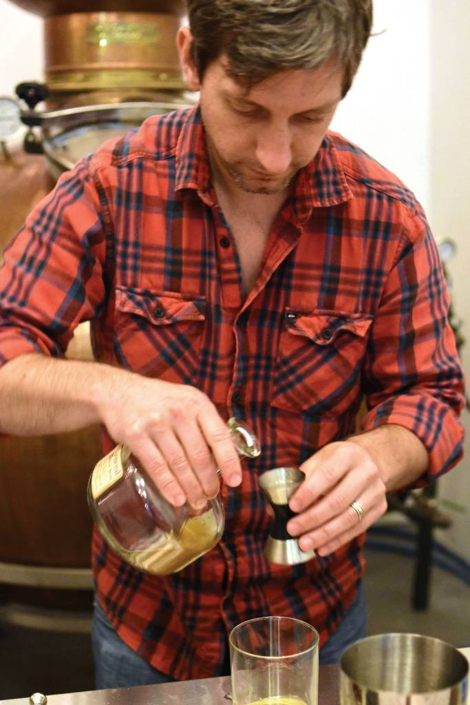 Ryan Max Riley mixes a cocktail at Ski Bum Rum Distillery in North Adams. Its intimate space includes a cocktail bar and distillation equipment.